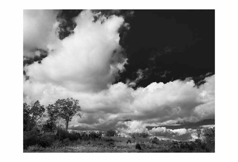 BW photograph of the field and sky behind Devils Den in Gettysburg, PA.