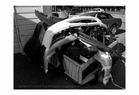 BW photograph of trashed car bumpers