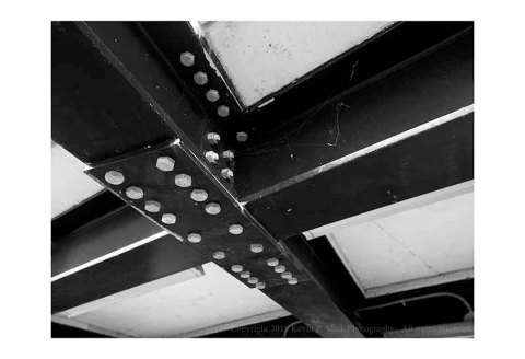 BW photograph of the girders supporting an elevated walkway