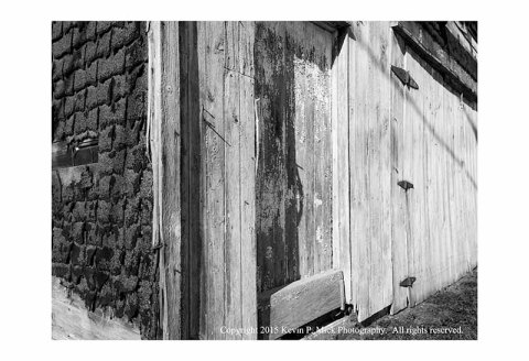 BW photograph of the corner of an old garage