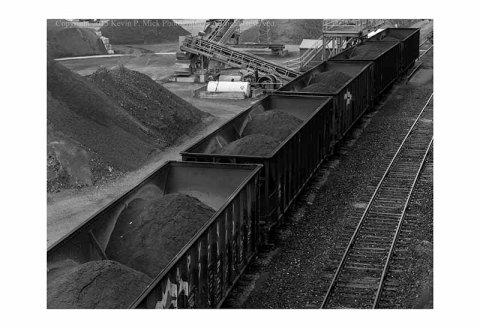 BW photograph of loaded rail cars