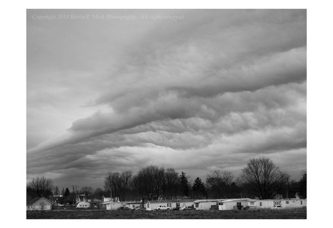 BW photograph of storm clouds over a trailer park