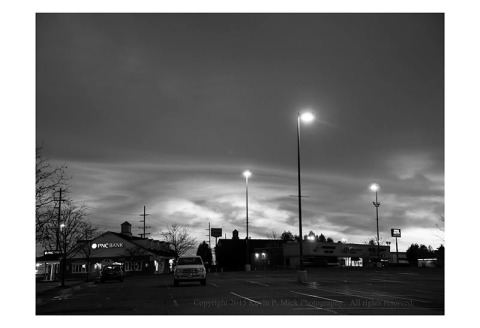BW photograph of the sunrise over a parking lot