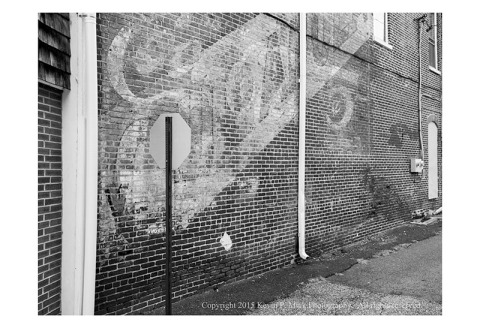 BW photograph of a faded wall advertisement in Havre de Grace