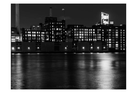 BW photograph of the Domino Sugar factory just before sunrise