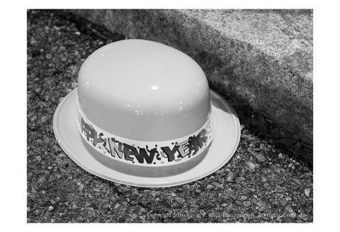 BW photograph of a New Years Eve hat lying in the gutter New Years morning
