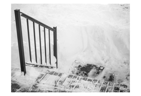 BW photography of a rail and steps after having been shovelled out