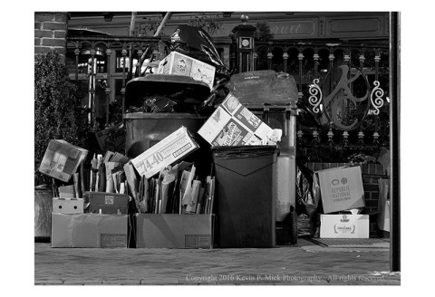 BW photograph of trash awaiting pickup on New Years morning