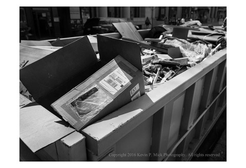 BW photograph of recyclable materials in a dumpster.