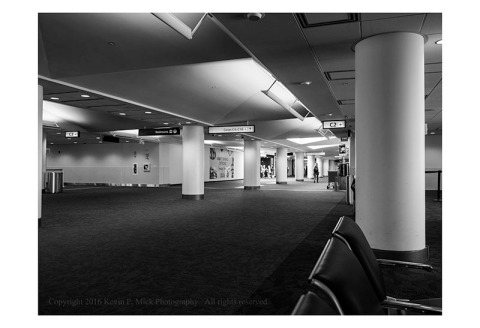 BW photograph of a mostly empty boarding gate at BWI.