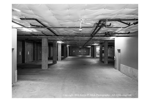 BW photograph of an empty parking garage.