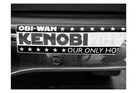 "BW photograph of an ""Obi-Wan Kenobi...Our Only Hope"" bumper sticker."