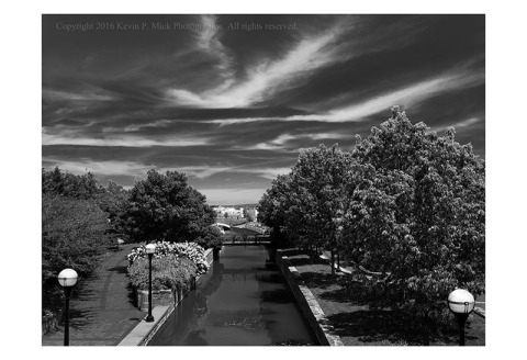 BW photograph of Carroll Creek in Frederick, Maryland, looking east.