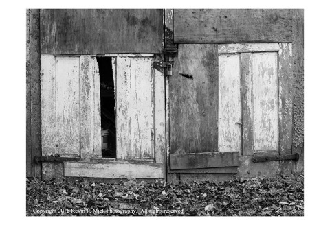 BW photograph of old weathered doors.