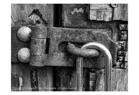 BW photograph of a rusted hasp.