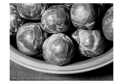 BW photograph of a bowl of brussel sprouts.