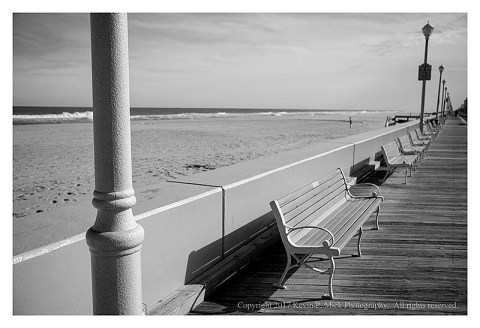 BW photograph of a section of the upper end of boardwalk at Ocean City, MD.