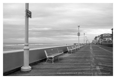 BW photograph of the upper end of the boardwalk at Ocean City, MD.