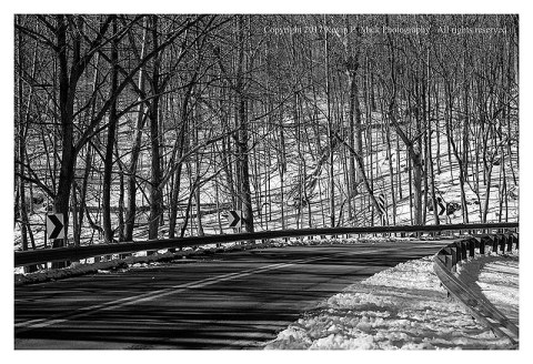 BW photograph of Klee Mill Road after a snow storm.