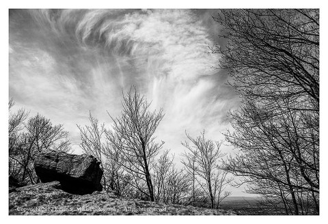 BW photograph of cirris clouds rising over South Mountain.