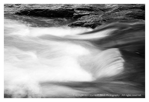 BW photograph of the water running at Morgan Run.