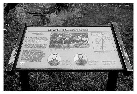 "BW photograph of Spangler's Spring educational plaque with the title ""Slaughter at Spangler's Spring""."