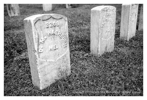 BW photograph of a grave at the Antietam National Cemetery-the soldier was from Maine.