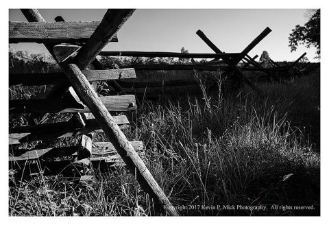 BW photograph of a rail fence in the early morn at Gettysburg.