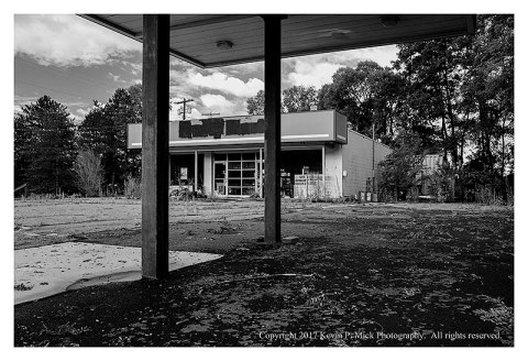 BW photograph of an abandoned gas station.