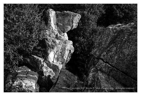 BW photograph of Wolf Rock.