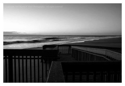 BW photograph of the early morn across a boardwalk at Bethany Beach.