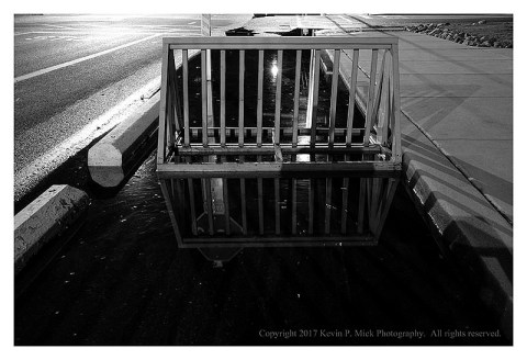 BW photograph of a bike rack flooded by Hurricane Jose at Bethany Beach.