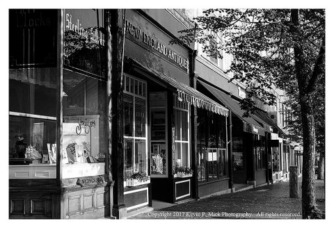BW photograph of some stores on Front Street in Bath, ME.