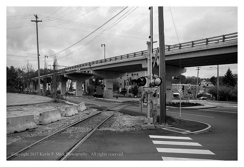 BW photograph of an overpass and intersection in Bath, ME.