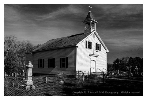 BW photograph of Trinity Lutheran Church and the cemetary.