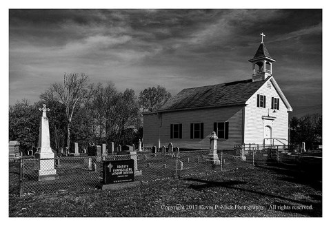 BW photograph of Trinity Lutheran Church and the cemetary-wide view.