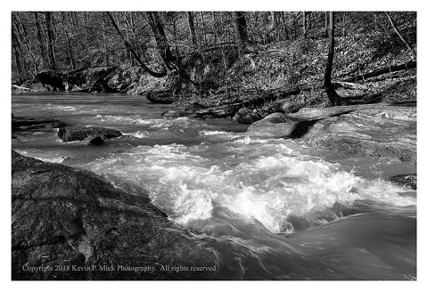 BW photograph looking downstream at Morgan Run after a relatively heavy rain.