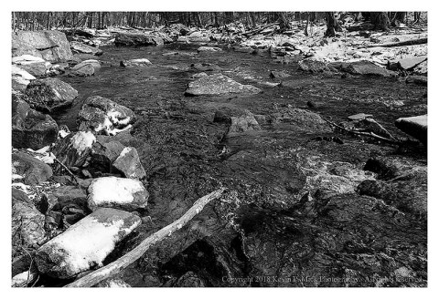 BW photograph of looking downstream of Big Hunting Creek in winter
