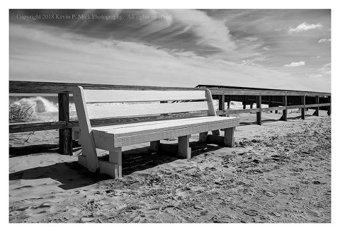 BW photograph of sand washed onto the boardwalk at Bethany Beach.