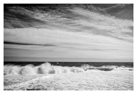 BW photograph of the roiled surf at Bethany Beach.