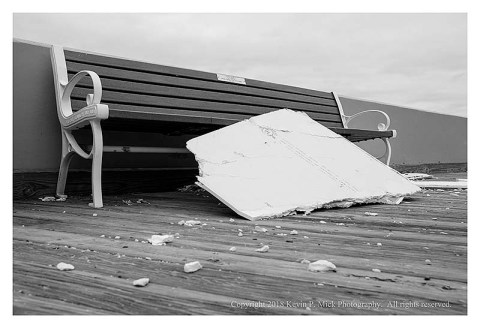 BW photograph of the drywall debris from the Days Inn in Ocean City laying against a bench.