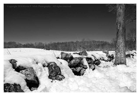 BW photograph of a low stone wall at Culp's Hill in Gettysburg, PA.