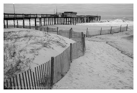 BW photograph of the Ocean City Fishing Pier with the roiling surf.