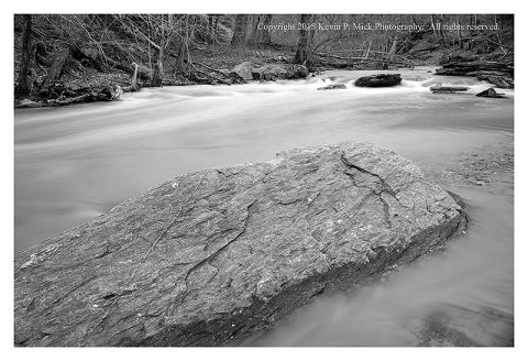 BW photograph of Morgan Run after a heavy rain with a prominent rock in the foreground.