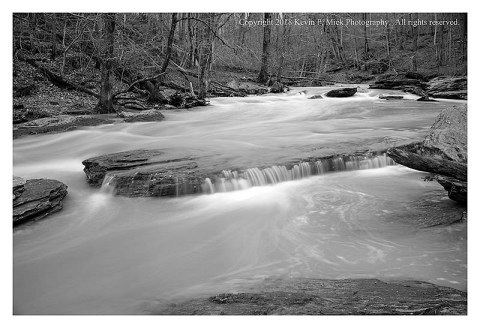 BW photograph of Morgan Run after a heavy rain-four rocks provide some framing for the water.