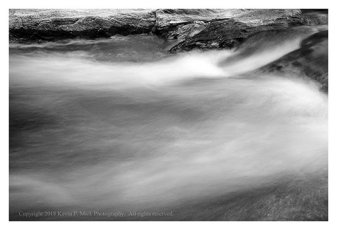 BW photograph of flowing water.