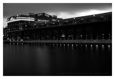 BW photograph of the City Pier in Fells Point at sunrise.