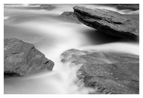 BW photograph of Morgan Run flowing between rocks the day after a heavy rain.