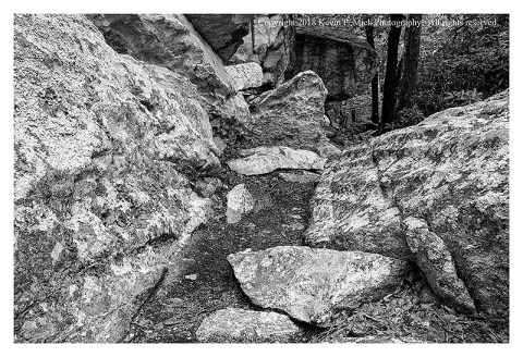 BW photograph of the base of Cat Rock.