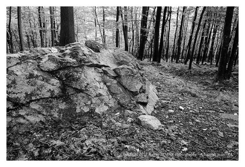 BW photograph of a large rock on the trail from the descent of Cat Rock.